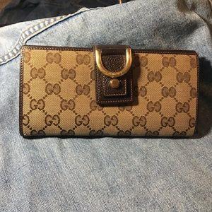 Gucci ring monogram zip wallet